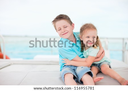 Happy brother and sister embracing each other