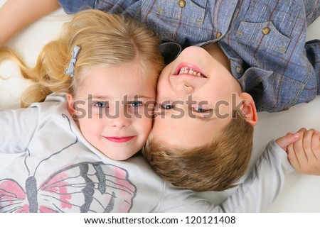 Happy Brother and Sister laying on the floor