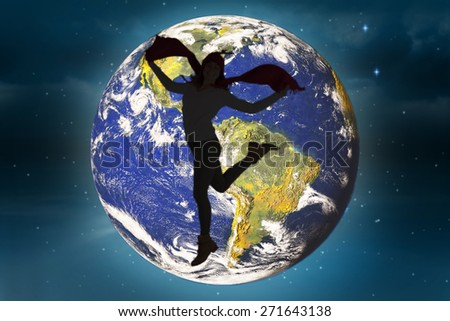 Happy brunette jumping and holding his scarf against stars twinkling in night sky