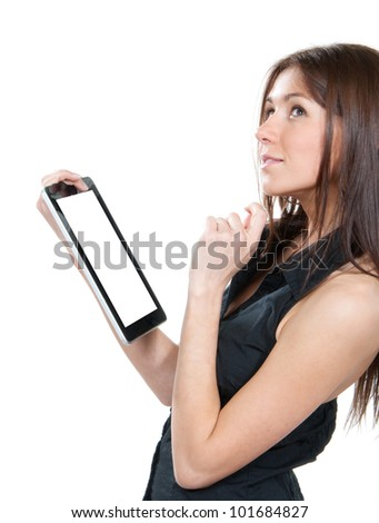 Happy brunette woman holding in hand new electronic tablet touch pad computer one finger touch digital screen and smiling