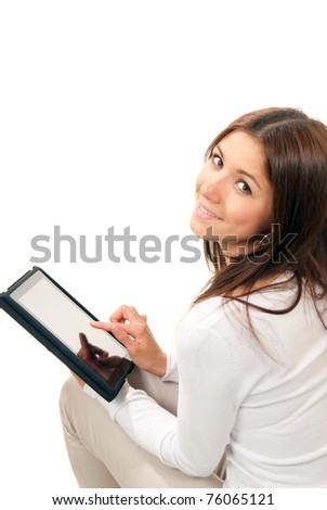 Happy brunette woman holding in hand new electronic tablet touch pad computer one finger touch digital screen and smiling, looking at the camera on a white background