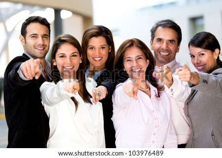Happy business group poiting at the camera - stock photo