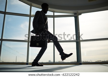 Happy business leader dancing against office window #622122242