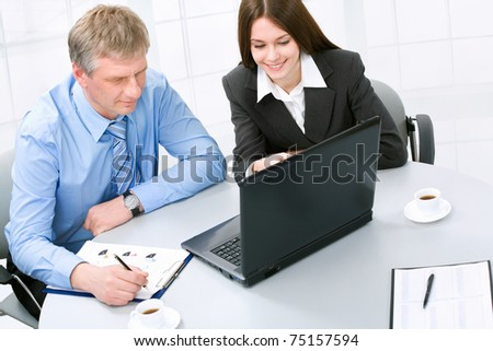 Happy business man and woman in a meeting