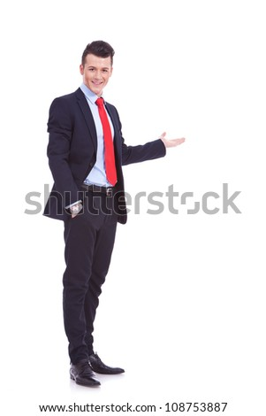 Happy business man giving presentation on white background , full body picture