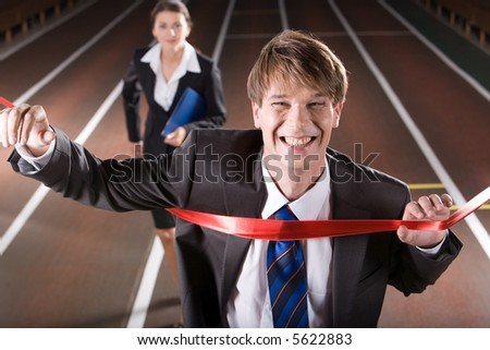 Happy business man is winning a business race