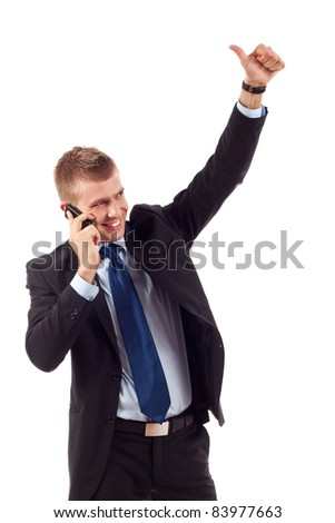Happy business man showing thumb up while talking on the phone