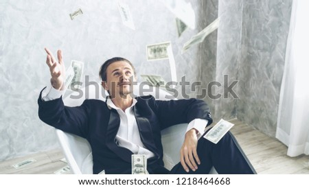 Happy business man very rich guy throw money dollar bills in air like rain money bill and banknotes US dollar bill on the bathtub - business success concept