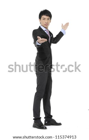 Happy business man with arm out in a welcoming gesture