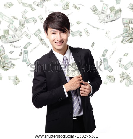 happy business man with earned dollar bills us money in suit pocket under a money rain - isolated over a white background, asian model