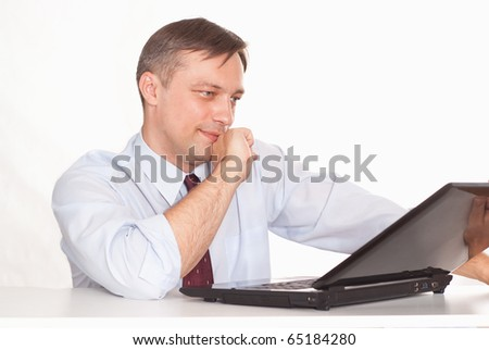 happy business man with laptop on white