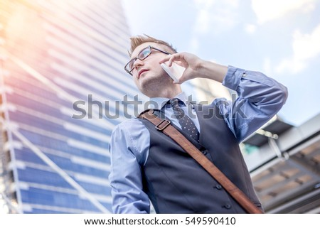Happy business men call by smart phone on business architecture background