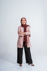 Happy business muslim woman portrait. Showing copy space on white background