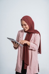 Happy business muslim woman portrait using the tablet