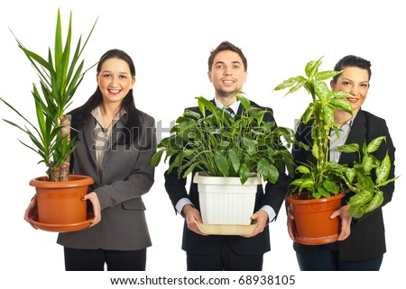 Happy business people holding big vases with plants and standing in a row  isolated on white background