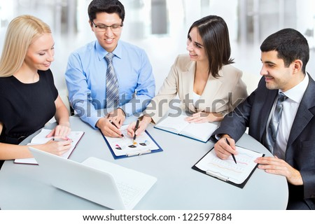 Happy business people in a meeting at office