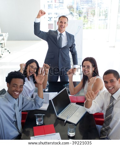 Happy business people in a meeting celebrating a success