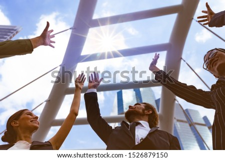 Happy Business people of Marketing team with a Partnership greeting powerful teamwork Join Hands cheerful of success after complete deal,Successful concept.
