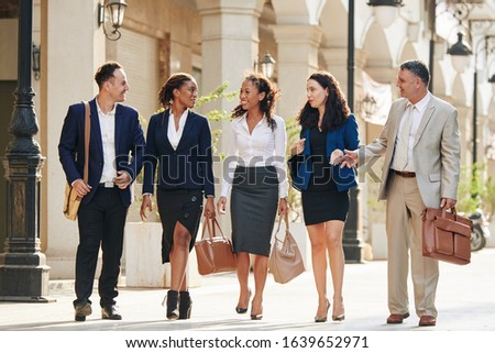 Happy business people walking in the street after successful day of work and discussing closed deal Stock photo ©