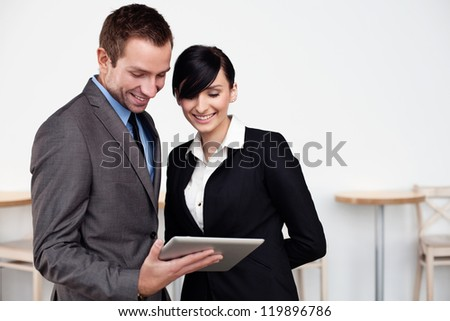 Happy Business people with digital tablet.