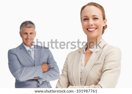 Happy business people with folded arms against white background