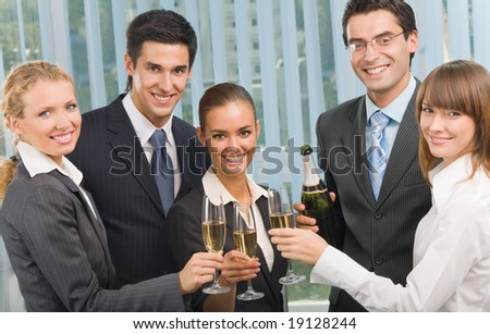 Happy business team celebrating with champagne at office