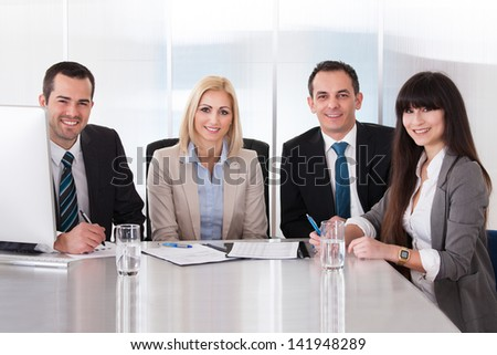 Happy Business Team In Office At The Meeting