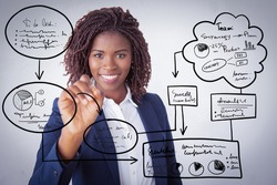 Happy business trainer writing virtual flowchart on glass board with marker. Young African American business woman standing isolated over white background. Corporate training concept