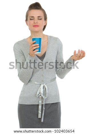 Happy business woman enjoying odor of coffee