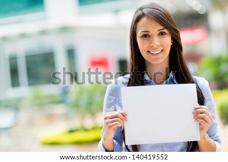 Happy business woman holding a banner and smiling