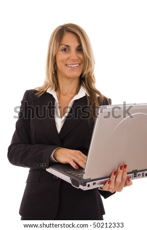 Happy business woman holding a computer - isolated on white - stock photo