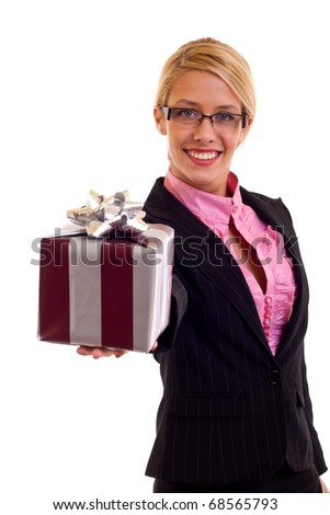 Happy business woman holding a gift in her hand, isolated