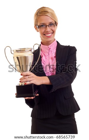 Happy business woman holding a trophy in her hand, isolated