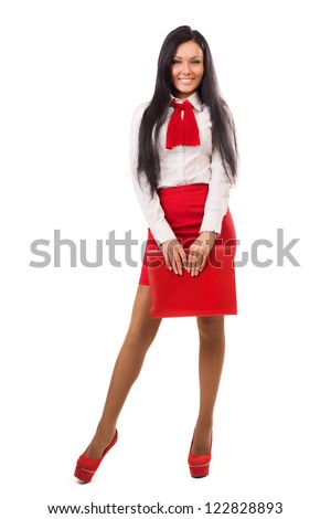 Happy business woman in red skirt over white