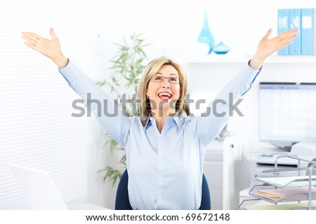 Happy  business woman in the office