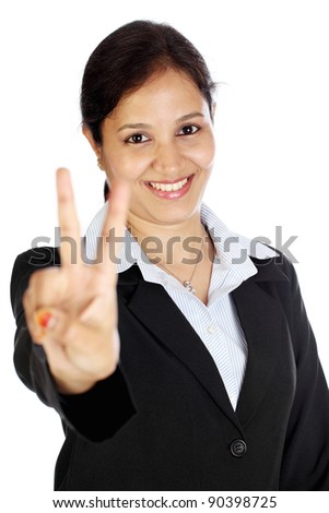 Happy business woman making the victory sign