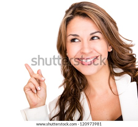 Happy business woman pointing an idea - isolated over white