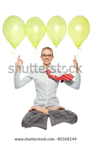 Happy business woman sitting in lotus pose and flying on air balloons, meditating, with flying tie
