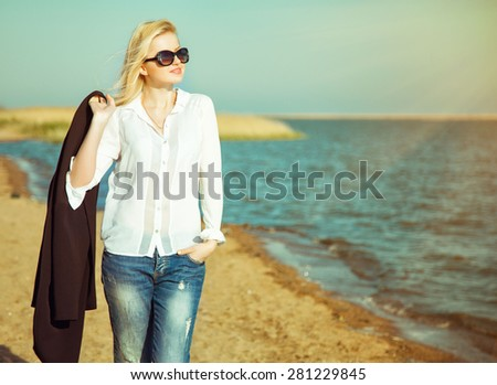 Happy business woman smiling and walking at the sea. #281229845