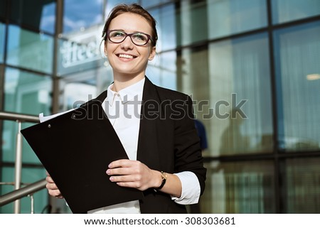 Happy Business woman, successful business lady portrait, manager holding documents.