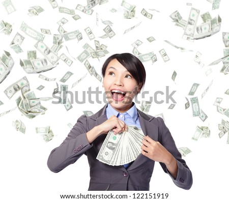 happy business woman with earned dollar bills us money in suit pocket under a money rain - isolated over a white background, asian beauty model