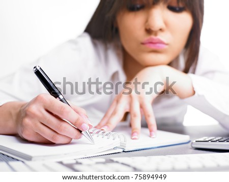 Happy Business Woman Writing in notepad