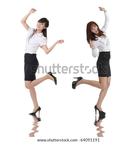 Happy business women dancing over white background.