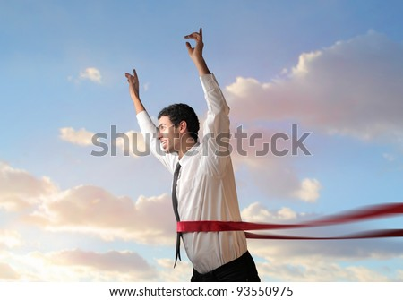Happy businessman crossing the line