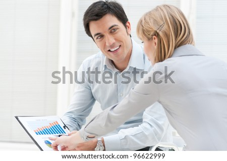 Happy businessman discuss with colleague on successful growing chart
