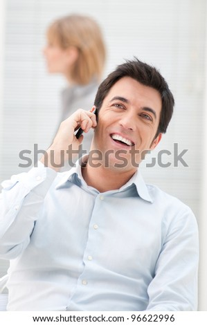 Happy businessman enjoy a conversation at mobile phone