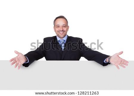 Happy Businessman Holding Blank Billboard On White Background