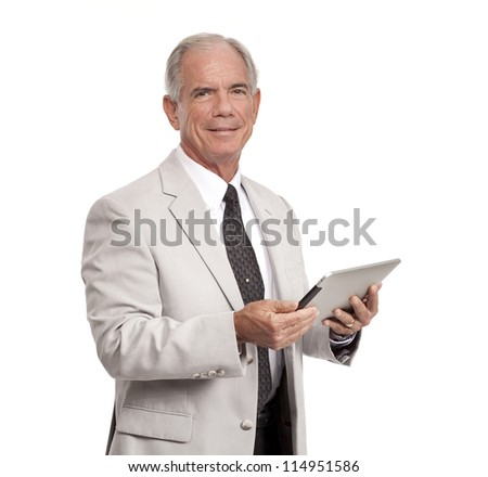 Happy Businessman holds a tablet