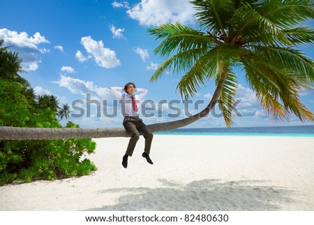 Happy businessman in formal clothes and tie sitting on the palm and relax