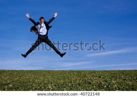 Happy businessman jumping for joy